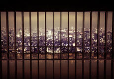 Night city behind the grating Stock Photos