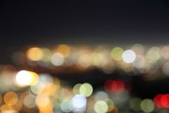 Night city bokeh background. In blue mode stock photography