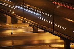 Night city with bridge and lighting road traffic Royalty Free Stock Image