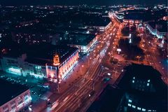 Night city with broadband traffic. Minsk, Republic of Belarus. Top view aerial drone. Night city with broadband traffic, bright lights, lanterns, windows. Minsk royalty free stock photos