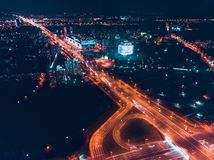 Night city with broadband traffic. Minsk, Republic of Belarus. Top view aerial drone. Top view night city, high-rise buildings, illuminated by thousands of royalty free stock photo
