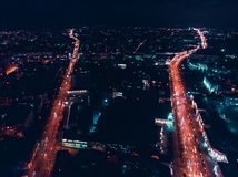 Night city with broadband traffic. Minsk, Republic of Belarus. Top view aerial drone. Two parallel roads and city lights. Minsk, Republic of Belarus. Top view stock images
