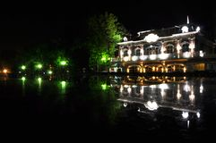 Night city. Building. fountain and reflex on water stock images