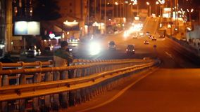 Night city cameraman shooting traffic on bridge road junction. Stock footage stock footage