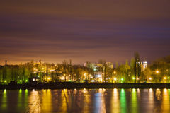 Night city, city lights reflected in the water, long exposure Stock Photo