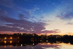 Night city, city lights reflected in the water, twilight Royalty Free Stock Photo