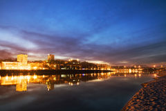 Night city, city lights reflected in the water, twilight over the river Royalty Free Stock Photo
