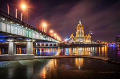 Night in the city. In front of a high-rise hotel building with the reflection in the Moscow River Royalty Free Stock Photos