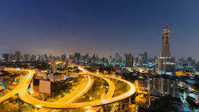 Night city highway and downtown background before sunrise, Thailand Royalty Free Stock Photography