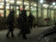 Night city landscape lantern rain blurred people.  Stock Image