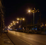 Night city life: road and street lamps, retro style. Small town Phang Nga, Thailand Royalty Free Stock Image