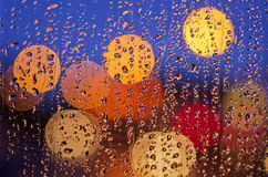 Night city life through windscreen: darkness and rain Royalty Free Stock Image