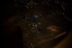 Night city lights from above the clouds Royalty Free Stock Image