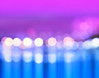 Night city lights bokeh with reflections background. Hd Stock Photo