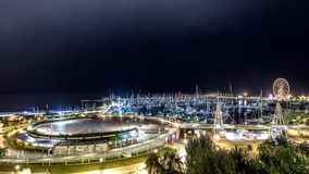 Night city lights on marina. Night to day timelapse stock video