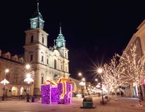 Night city lights in old town Warsaw, Poland. Christmas decorati. Night city lights in the old town Warsaw, Poland. Christmas time decoration Royalty Free Stock Photography