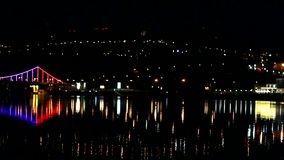 Night city lights over the river stock video