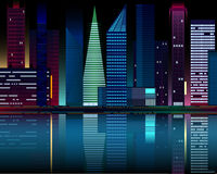 Night city lights reflected in the water. Stock Photos