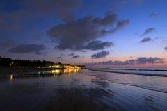 Night lights reflection after sunset at Kuta beach, Bali, Indonesia Stock Photo