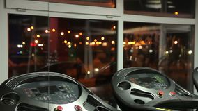 Night city lights seen through window of empty gym, modern sports equipment. Stock footage stock video
