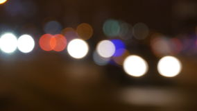 Night city lights and traffic background. Out of focus background with blurry unfocused city lights and driving cars and. Car light stock video