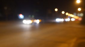 Night city lights and traffic background. Out of focus background with blurry unfocused city lights and driving cars and. Car light stock footage