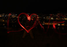 Night city and love - blur photo of red lamps Stock Photo
