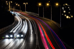 Night city in the motion. Highway with lights. Cars driving on the freeway Royalty Free Stock Image