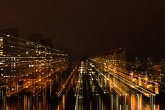 Night city in motion of light lines royalty free stock photo