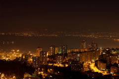 Night city near the sea. Night mediterranean city near the sea Stock Image