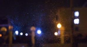 Night city, neon lights, blurred bokeh background, raindrops. Night view. stock photo