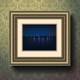 Night city painting in image frame on a wall Royalty Free Stock Photo