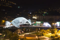 Night city park and Bridge of Peace in old part of Tbilisi Royalty Free Stock Images