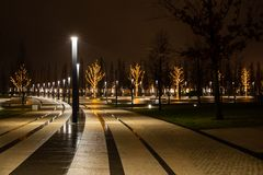 Night city park in the city of Krasnodar, Russia. The park is made in the same design style and contains a lot of geometry and stock photography