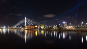 Night city reflections in river. Riga, Latvia Royalty Free Stock Image