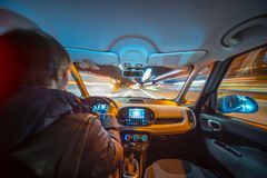 Night city road view from inside car royalty free stock image