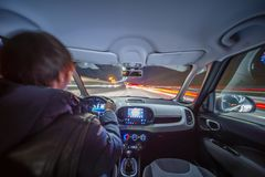Night city road view from inside car stock photography