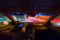 Night city road view from inside car Royalty Free Stock Photography