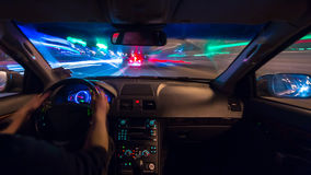 Night city road view from inside car Royalty Free Stock Photos