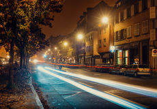 Night city, roadway , cars are parked along the road Royalty Free Stock Photos