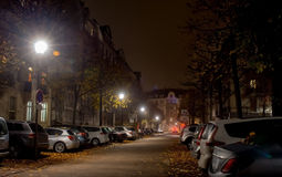 Night city, roadway , cars are parked along the road Royalty Free Stock Images