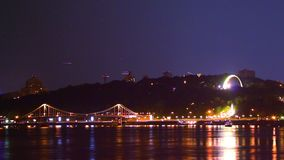 Night city scape, shining lights, boats, air traffic stars shine. Stock footage stock footage