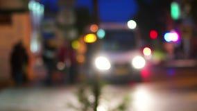 Night City Scene. Publick transportation people get in small bus defocused shot. Blurred urban Scene stock video