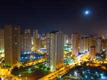 Night city skyline and moon Royalty Free Stock Photo