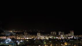 Night city skyline timelapse. Road junction traffic. Lights flicker in windows. Night city skyline timelapse. Top aerial panoramic view of modern city from tower stock video