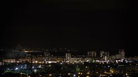 Night city skyline timelapse. Top aerial panoramic view of modern city from tower rooftop. Road junction traffic. Lights. Flicker in windows. Residential flats stock video footage