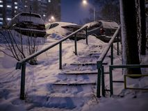 Night city snowy ladder at winter royalty free stock images