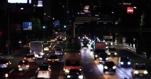 A night city street at the downtown in Setagaya Tokyo tilt shift. A night city street at the downtown tilt shift. Setagaya district Tokyo / Japan - 08.06.2019 stock video footage