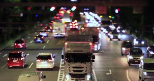 A night city street at the downtown in Setagaya Tokyo tilt shift. A night city street at the downtown tilt shift. Setagaya district Tokyo / Japan - 08.06.2019 stock footage