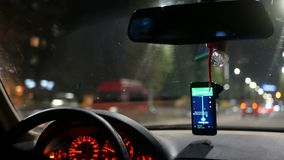 Night city taxi car. Night city traffic inside taxi car stock video footage